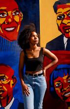 Beautiful Artist In Golden Light Displays Her Mural Of Black Heroes