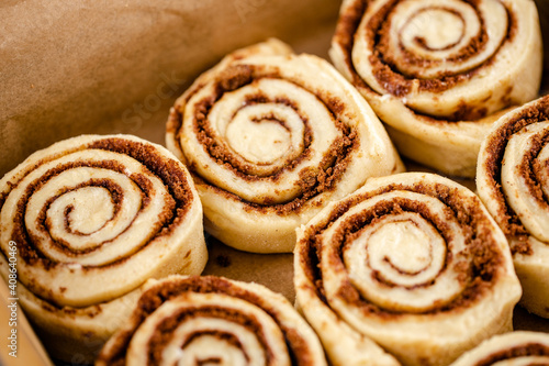 Fotografiet Raw cinnamon roll dough being prepared ready for baking