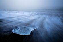 Chunk Of Ice On Sea Shore At Diamond Beach Near Jokulsarlon Glacier Lagoon In Foggy Weather, Iceland