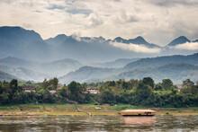 Scenic View Of Mekong River Against Mountain Range, Luang Prabang, Laos