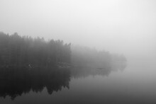 Tranquility And Silence In Black And White. Landscape Scenery On A Foggy Morning. Image Has Some Noise Effect Applied.