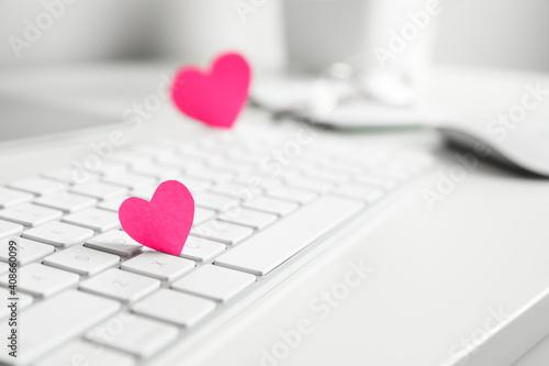Obraz Keyboard with pink hearts on white table, closeup. Valentine's day celebration - fototapety do salonu