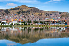 Reflections Of Houses In Puno, Lake Titicaca, Peru