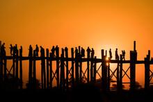 Silhouette People Walking On U Bein Bridge Against Clear Sky During Sunset, Amarapura, Mandalay, Myanmar