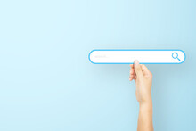 Hand Holding Paper With Search Bar On Light Blue Background. Concept Of Searching Information Data On Internet Networking