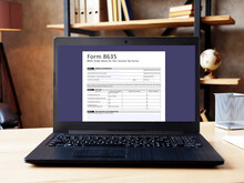 Business Concept About  Form 8635 BPOL Order Blank For Fed. Income Tax Forms   With Sign On The Piece Of Paper.