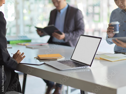 Close up view of computer laptop include clipping path on meeting table