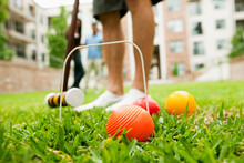 Young Man Playing Croquet In A Lawn