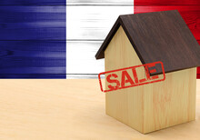 The Concept Sale Of Apartments, Of Real Estate Mortgages, Citizenship And Accommodation, As Well As Investment In A Future Home. France Flag On Wooden Background.