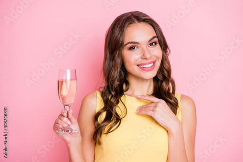 Photo of adorable wavy hairdo person hand hold drink glass toothy smile isolated on pink color background © deagreez