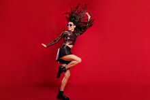 Full Body Profile Side Photo Of Charming Lady Dance Fly Hair Raise Hand Isolated On Red Color Background