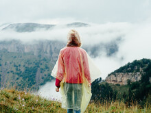 Woman In The Mountains With A Cape On Her Shoulders And Mountains Fresh Air Fog Nature