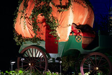 Green Pumpkin Wagon Covered With Ivy.