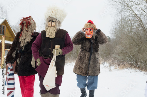 People in demon masks are caroling in a Russian village Fototapet
