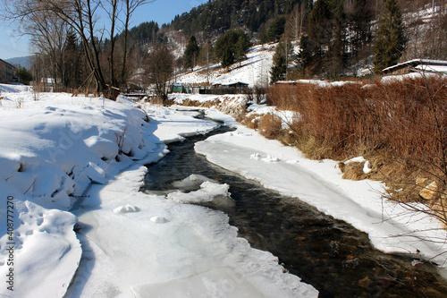 Canvas Print Creek with melting snow
