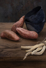 Harvest Raw Sweet Potato Or Yam And Dried Horseradish Root On Wooden Table. Selective Focus