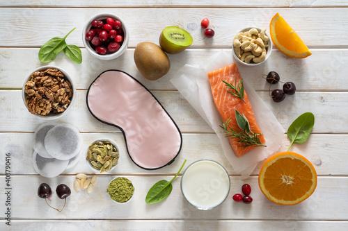 Fototapeta Selection of food for better sleep insomnia rich in tryptophan and melatonin, co