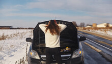 Caucasian Female Having A Problem With Car On A Roadtrip Upset Woman Emotionally Reacting On Overheated Car Standing On The Roadside With The Open Hood