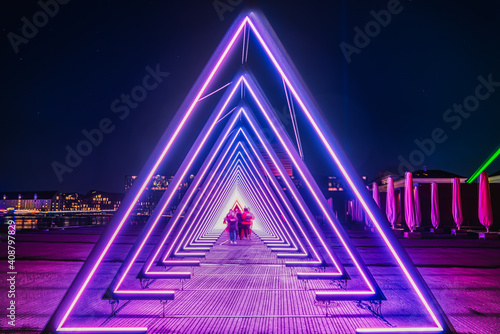 Purple coloured gate of light or purple light tunnel installation made of triang Wallpaper Mural
