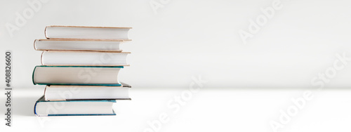 Fototapeta stack of books on white background obraz