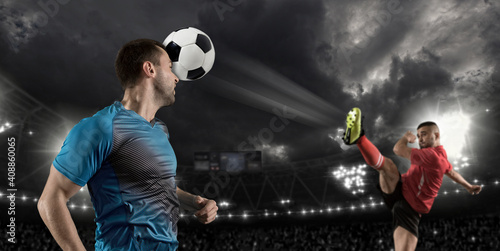 Soccer player hitting ball with head Fototapet