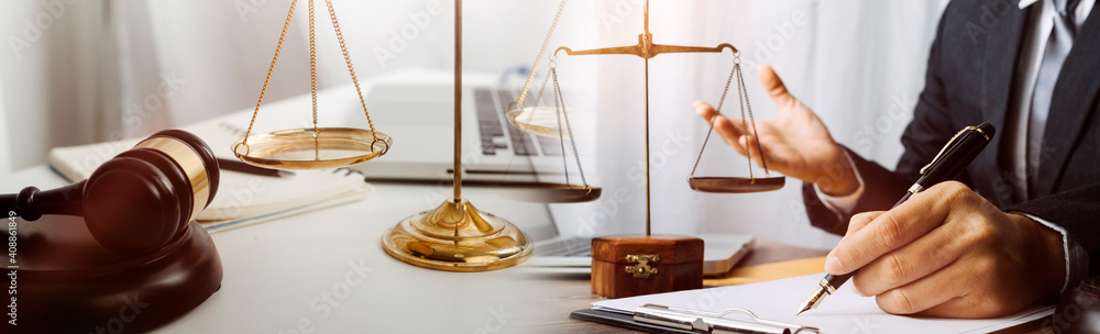 Fototapeta Business and lawyers discussing contract papers with brass scale on desk in office. Law, legal services, advice, justice and law concept picture with film grain effect