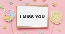Gifts With Note Letter On Isolated Pink Background With Sweets, Love And Valentine Concept With Text I Miss You
