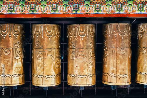 Billede på lærred Buddhist prayer drums in Dharamsala, Om Mani Padme Hum