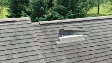 Aerial Drone Close Up Of Roof Damage, Missing Shingles
