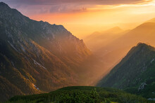 Golden Sunset With Sunbeams In Big Mountain Landscape