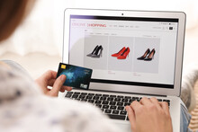 Woman With Credit Card Using Laptop For Online Shopping Indoors, Closeup