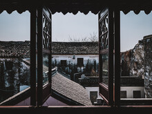 Vintage Open Windows With A View Of Old Town Ancient Weathered Residential Buildings