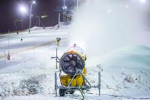 Snow Cannon Gun, Artificial Snow Making Machine On The Slopes Of Ski Resort, Ski Lift And Piste