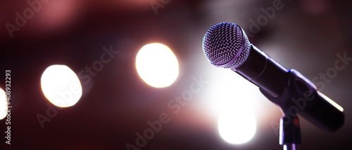 Fotografiet Close up of microphone on stage lighting at concert hall or conference room