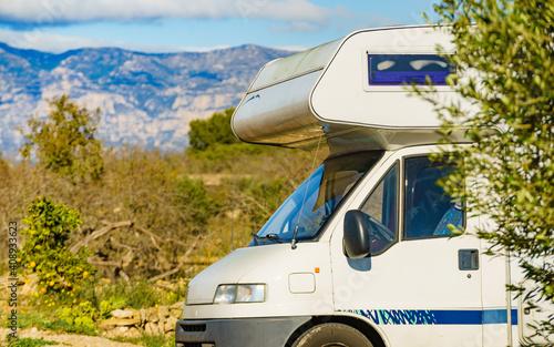 Slika na platnu Camper against mountains nature