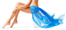 Beauty Woman Legs Skin. Leg Wax Depilation. Body Care. Flying Blue Fabric Wave. Isolated White