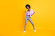 canvas print picture Full body photo of cool positive dark skin lady look empty space toothy smile isolated on yellow color background