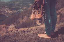 Barefoot Woman Travel With Broken Shoes - Concept Of Freedom And Alternative Free Independent Lifestyle For Female People - Unrecognizable Girl With Valley View Enjoy Outdoor Leisure Activity
