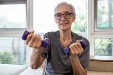 Healthy And Strong In Old Age,Happy Smiling Asian Senior Woman Lifting Dumbbell Weights,fitness Elderly Grandmother Wear Eyeglasses, Exercising With Dumbbells,health Care,healthy Lifestyle Concept