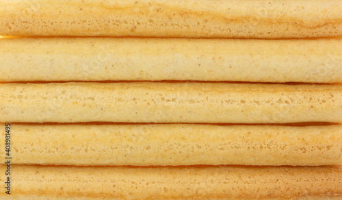 Obraz Close view of small dried breadsticks in rows. - fototapety do salonu