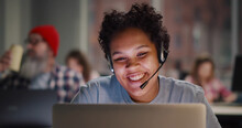 Call Center Agent With Headset Working On Support Hotline In Modern Office