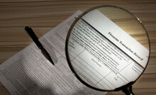 Magnifying Glass Inspecting Public Domain Gun Purchase Form