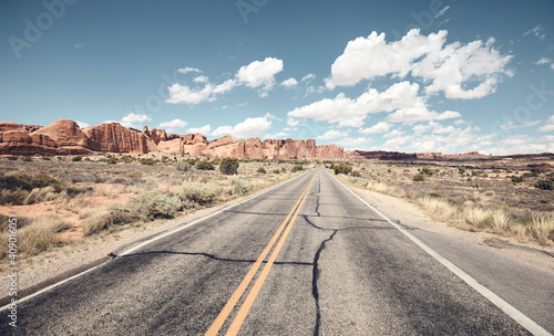 Fotografia Road in Arches National Park, color toning applied, Utah, US.