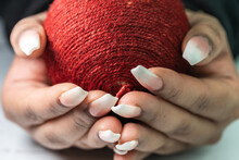 Isolated Female Hands Holding Textured Red Ball. Power