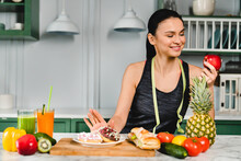 Fit Young Caucasian Woman Choosing Healthy Food Instead Of Eating Doughnuts