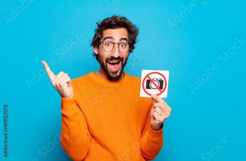 Obraz young bearded man forbidden photo concept - fototapety do salonu