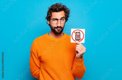 Fotografia young bearded man forbidden phone concept