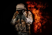 A Soldier On Fire Holding A Gun. Fight Against Terrorism