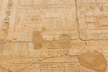 Ancient Egyptian Hieroglyphs On The Wall In Karnak Temple Complex In Luxor, Egypt