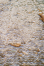 Fabric For Decor And Table Decoration With A Texture Of Scales. Sequins And Shiny Plates.